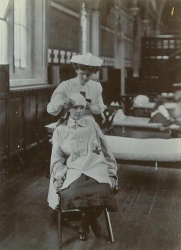 Red Cross inspection, 1911 - practising a head bandage on a younger pupil LF310-36
